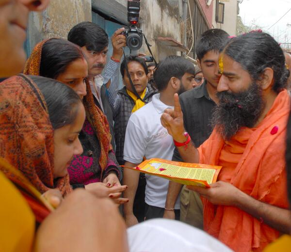 In pictures: Baba Ramdev starts visiting house holds to seek