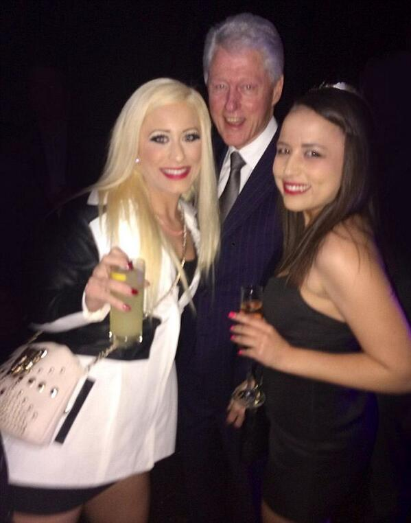Bill Clinton pictured posing with two PROSTITUTES at star-studded charity event http://t.co/deQeWnS9ew http://t.co/T2BAR5jHSH
