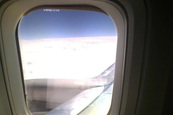 @acpress The captain just said we are somewhere over Colorado... here's a view from seat 14A (exit row): #ACPressAMA http://t.co/iVwtgLJjFh