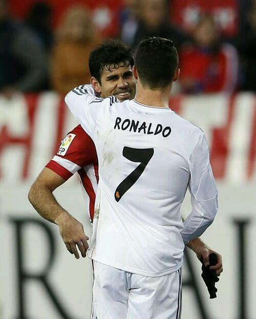 Cristiano Ronaldo and Diego Costa hug it out at the end of a brilliant Madrid derby, 2 2