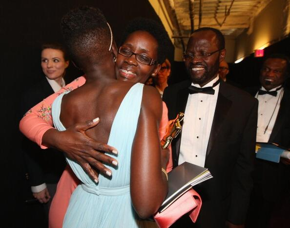 OMG this pic. #AfricanParents RT @Afripopmag Anyang' & Dorothy Nyong'o congratulate daughter Lupita on her Oscar win. http://t.co/279MTmIILk