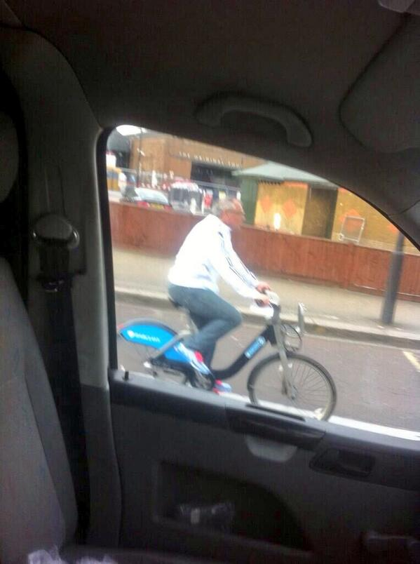 Incredible! Fulham manager Felix Magath pictured cycling through London on a Boris Bike [Picture]