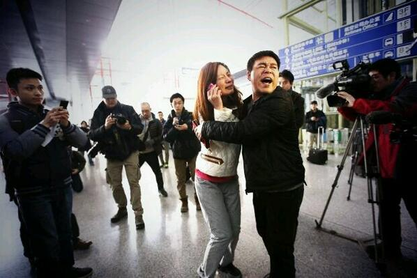 Scene at the Beijing airport of anxious family members waiting for news of missing MAS plane. http://t.co/sSBkqsLO7q