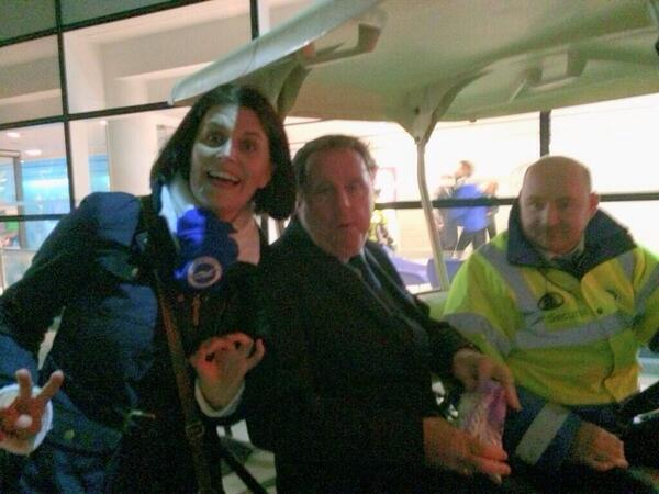 A female Brighton fan photobombs QPR manager Harry Redknapp flashing a 2 0 hand sign [Picture]