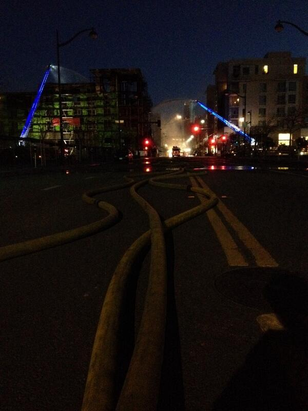 At least eight hoses still aimed at remnants of building scorched by #MissionBayFire http://t.co/TxoZjm59ew