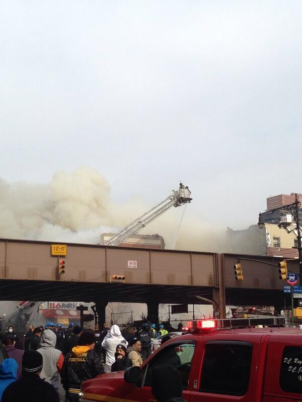 I'm up in East Harlem #NYC walking around and an entire building exploded. The scene up here is crazy. Not good. http://t.co/yN7e82qcxM