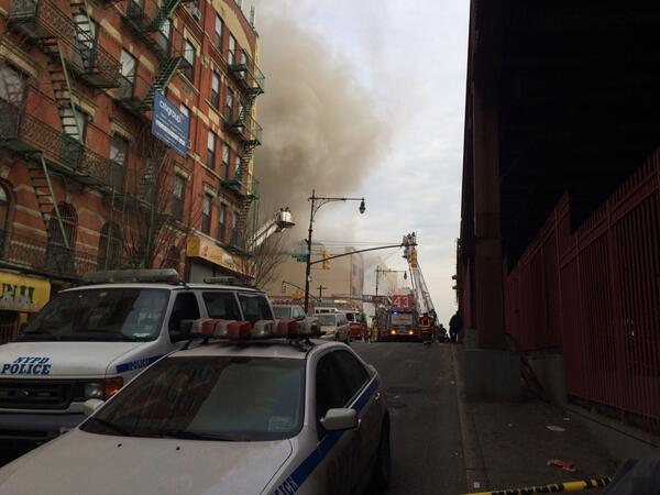 This is what I can see of building collapse from Park Ave between 115&116. Fire trucks spraying hoses at building. http://t.co/ze3z5eQXBy