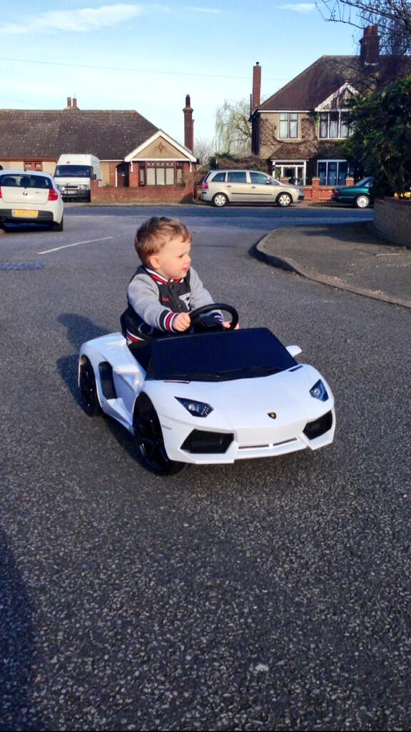 The sun is out and Lewis has the roof off his Aventador