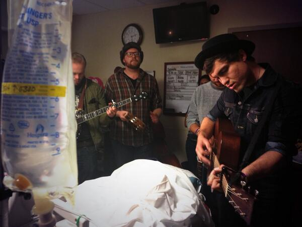 The band @jaredandthemill playing inside @masonendres hospital room. She's a victim of the #sxswcrash. @KVUE http://t.co/4nqPfYaJh9