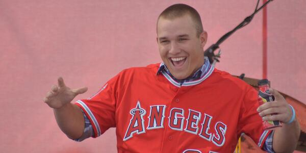 Mike Trout celebrating with fans during his press conference.