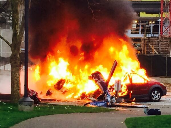 #BREAKING: Helicopter has crashed near Seattle's Space Needle. 2 cars on fire.  Pic: @KellyKOMO4 http://t.co/FvZAEwmt75