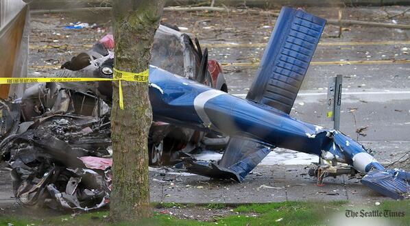 Wreckage of helicopter tail/car at #Seattle Center crash scene. Investigation continues, Space Needle closed for day. http://t.co/jrfjKVslQ2