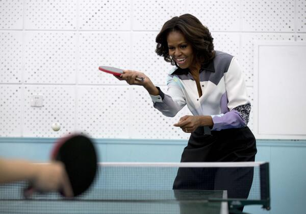 Michelle Obama begins China vacation by playing ping-pong