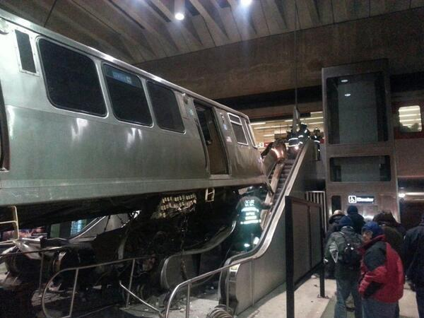 CTA derailment at O'Hare: Incredible photo by Milka Overton shows the car on the escalator. http://t.co/zAolGXD9kq