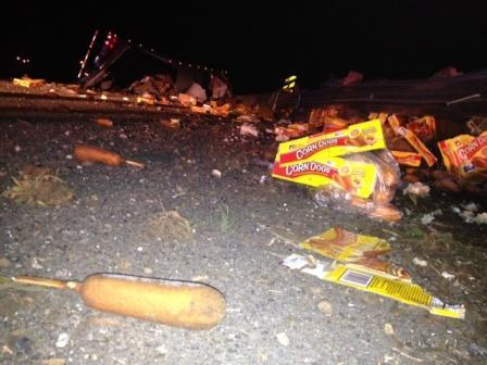 Corn dogs are scattered all over I-220 in north LA after 18-wheeler overturned this morning. http://t.co/xI5ry6nJeU http://t.co/l0GdqvX0bR
