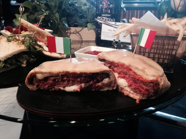 A pizza burger? Yep. With Nolan Ryan Beef. $14.59, but only at Capt Morgan Club. #rangers http://t.co/p9Ibp3uKc1