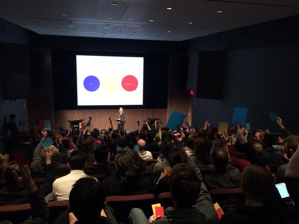 Audience members cast their votes on the motion: blue = for, red = abstain, yellow = abstain. Blue wins. #desviolenz http://t.co/1ouW5mndhg