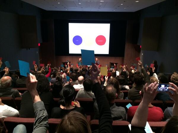 The audience votes again to see if their opinions shifted. More red (against the motion) than before. #desviolenz http://t.co/zTkMyYwrWi