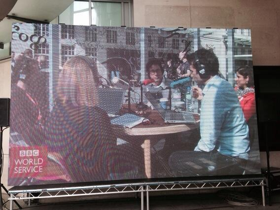 "Here's @BBCRosAkins and guests on the ""Jumbotron"" screen outside the BBC #Freedom2014 http://t.co/8h6i90CzEO"
