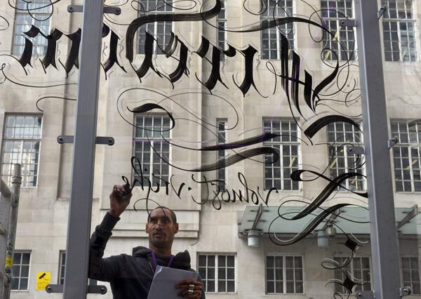 "Calligrapher Paul Antonio is writing ""freedom"" in 100 languages on a glass box at Broadcasting House #freedom2014 http://t.co/4KQwyvFW7M"