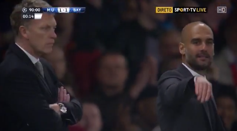 Bayern coach Pep Guardiola gestures that Man Uniteds Wayne Rooney dived to get Schweinsteiger sent off