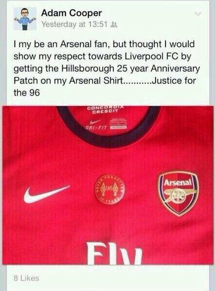 A Gunners fan puts a Hillsborough 25th anniversary Liverpool badge on his Arsenal shirt [Picture]