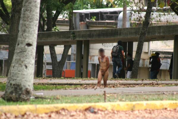 URGENT: Student was stripped/beaten by paramilitary after being caught protesting against maduro´s regime #UCV http://t.co/HJYR4PAnn0