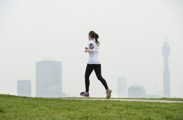 A woman jogs in London as pollution and Sahara desert sands blanket parts of Britain (Xinhua/EPA) http://t.co/tYdroxvMrF