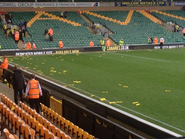 Hughton was hit by one of those cardboard clappers thrown from the crowd at full-time. A fair few on the pitch #ncfc http://t.co/NSGRhnH0Ye