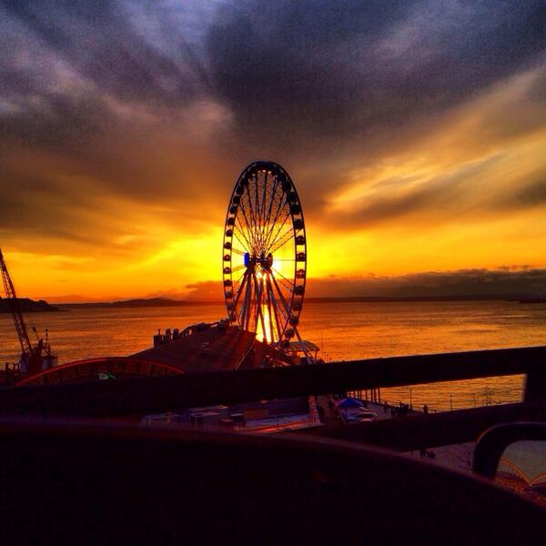 Wow. Caught this sunset on the Seattle waterfront-- more dramatic than most days. [cc @adventuregirl] http://t.co/9lK89ksCLM