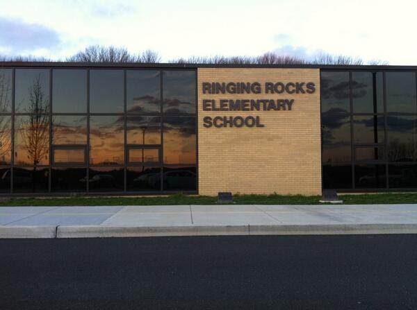 On my way in to the Pottsgrove School Board meeting, I noticed the sunset reflected in the windows of Ringing Rocks. http://t.co/o3p3Vcyp46