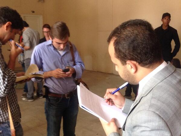 Lawyer Osama El Mahdy writing a request to judge to let journalists and myself back into the court room #AJtrial http://t.co/urFBd3XRd8