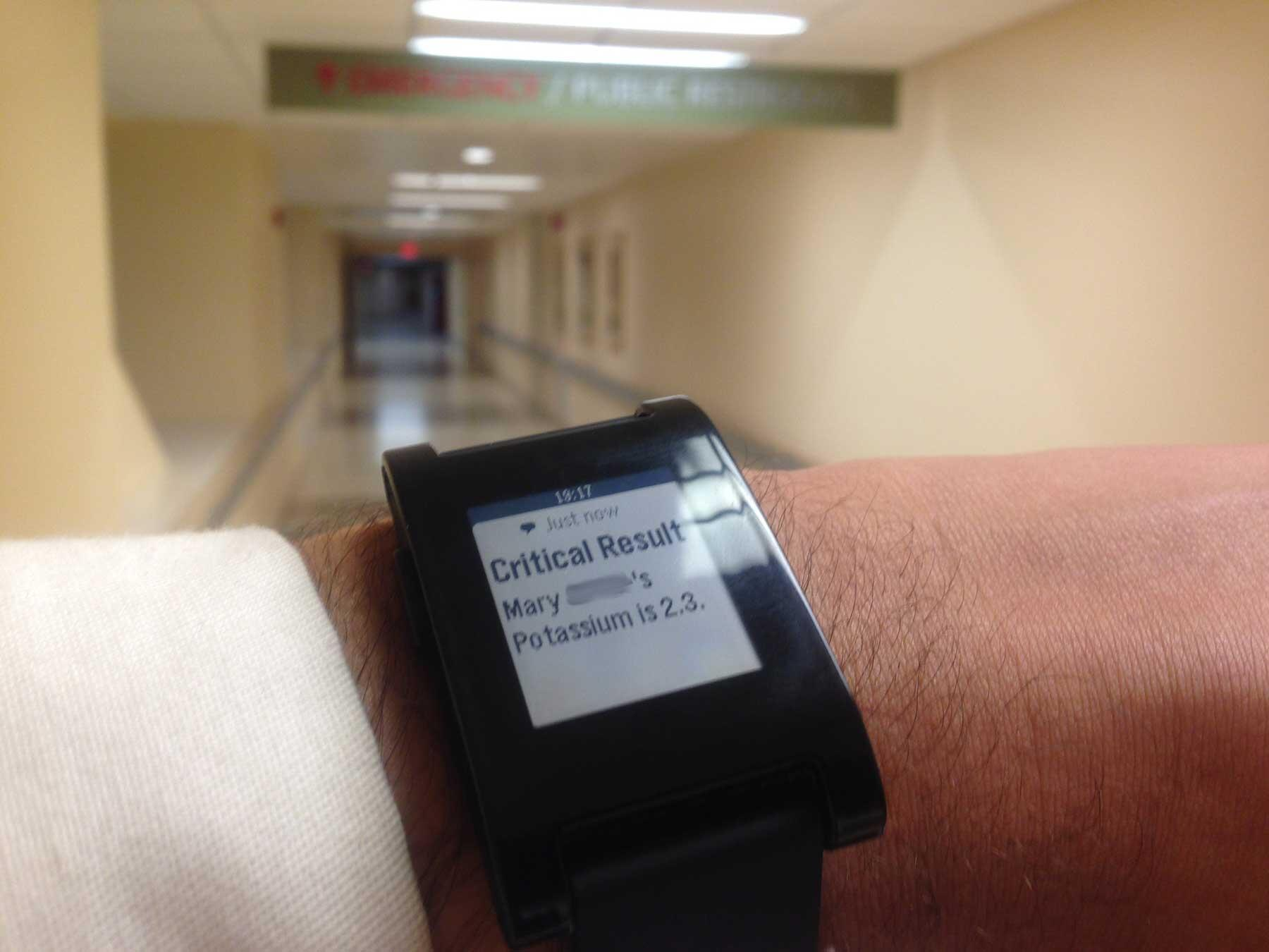 Pebble smartwatch displaying critical lab result