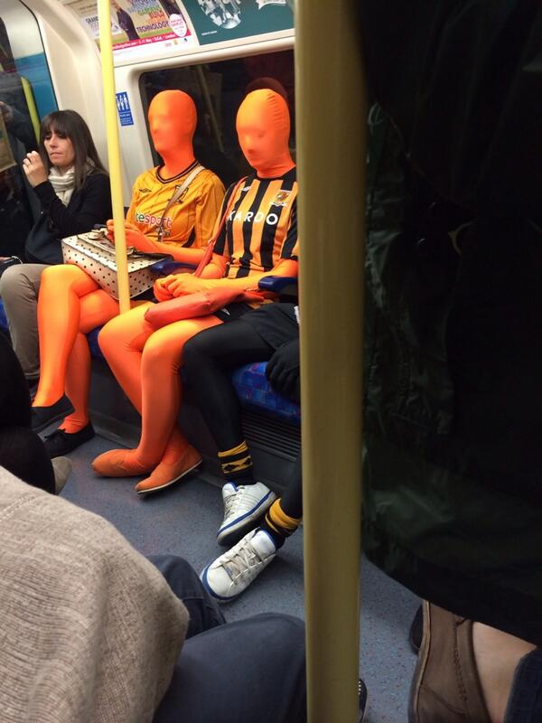 WTF? Hull fans dressed in Morph Suits on the London Tube [Picture]