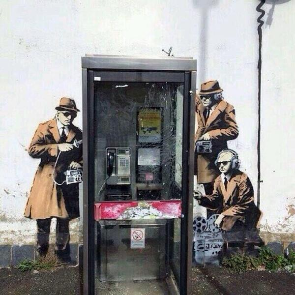 New #Banksy art showing government agents spying on a phone box appears on side of Cheltenham house near to GCHQ. http://t.co/SKYptEFAtD