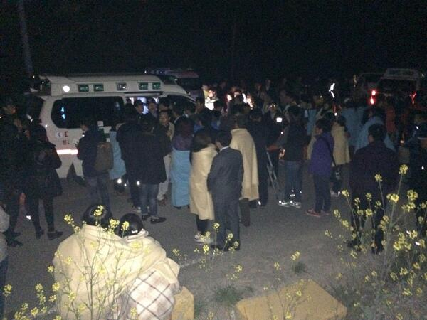 At port. Parents are asked to stand in line to identify two newly found dead female bodies in ambulance. http://t.co/0pklyYnQUp