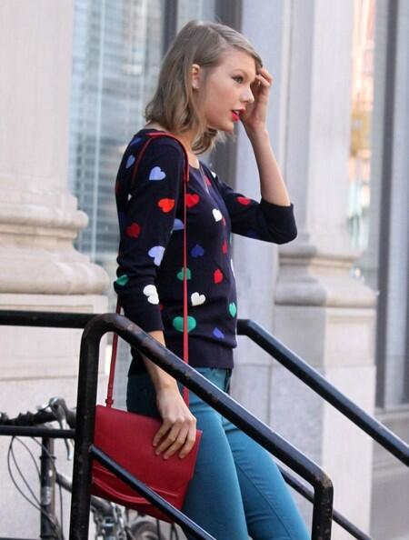 "From her ""Red"" tour to our red door! Taylor Swift was spotted in New York City wearing our heart intarsia sweater. http://t.co/JUxjQsiaCS"