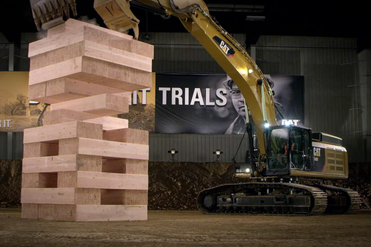Caterpillar machines play Jenga with 600-pound wooden blocks: http://t.co/BVLMmBsJd8 http://t.co/3UFBS14rex
