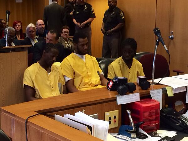 Three of the defendants just entered, handcuffed to each other http://t.co/zJG49FffQI
