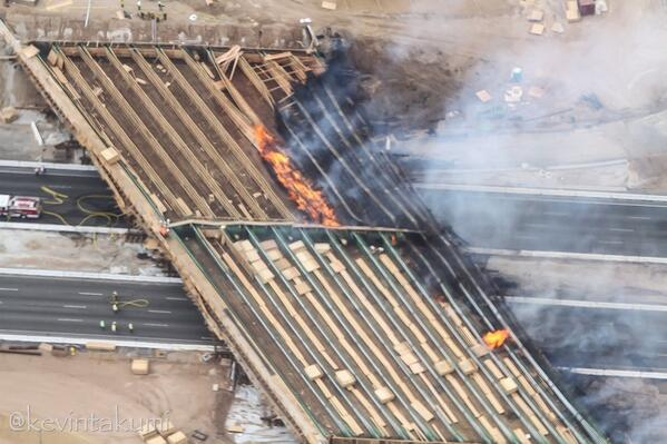 Crazy phoot -- what it looks like when a freeway bridge catches on fire. Another winner from @KevinTakumi http://t.co/JunbdoWFzk