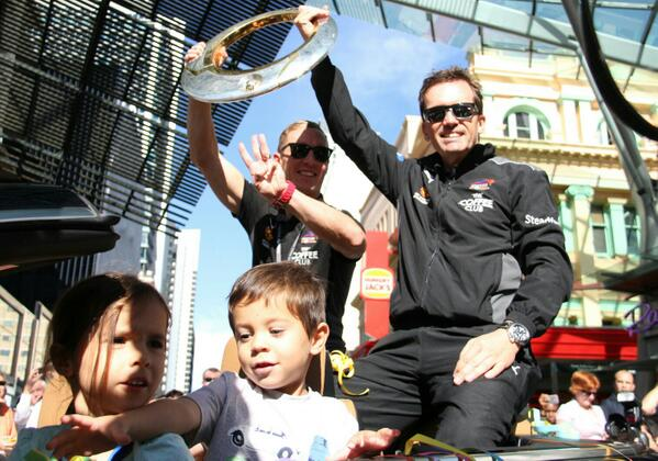 #Brisbane #Roar parade today. Matt Smith's kids ride in the front seat. Matt and Mike Mulvey hold trophy @abcnews http://t.co/vP9VCZYjn6