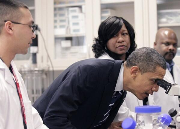 President Barack Obama looks through a microscope during his tour the Bio-technology program at Forsyth Tech Community College in Winston-Salem, N.C., Monday, Dec. 6, 2010.