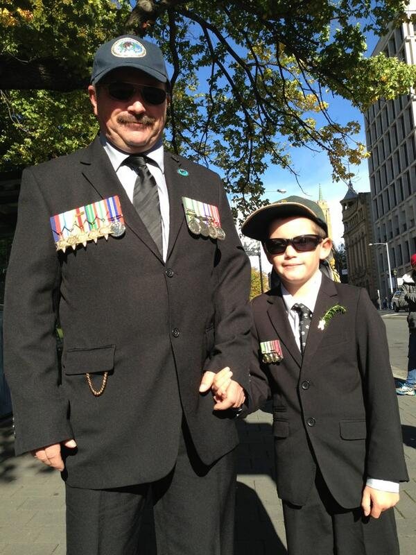 Scott Robinson and son marching . Scott served in East Timor #abcanzac http://t.co/TC9jJMZQtZ