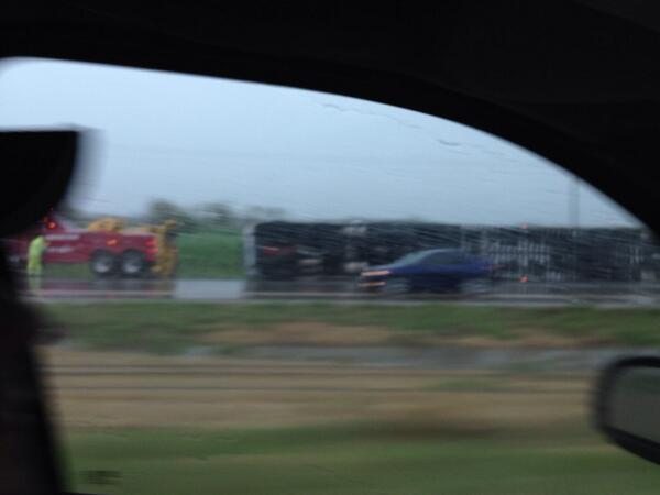 Mile marker 38 on 1-70.... Semi on its side. @fox4wx #fox4kc http://t.co/s3bUatUtiH