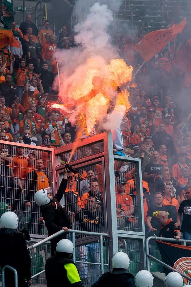 A Zaglebie Lubin fan was set on fire by security after they tried to put out the flare [Picture & Video]