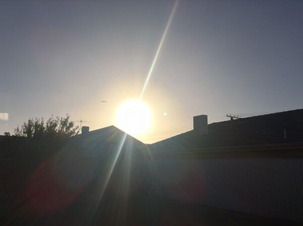 An attempt at capturing the #eclipse over #Adelaide - almost looks like there are two Suns http://t.co/mhJicchjDM