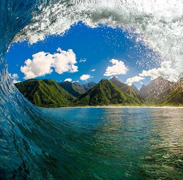 """Tahiti peaks through the wave"" via @clarklittle #travel #photography http://t.co/5iIsU6DczN"