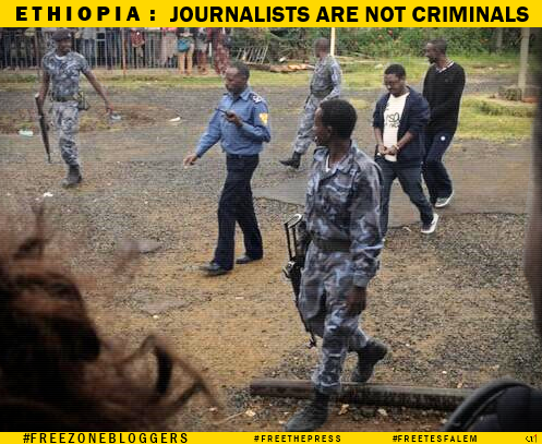 Respected Ethiopian journalist @tesfalemw (2nd from right) in handcuffs (photo via @halelule) #Ethiopia #FreeTesfalem http://t.co/RhNsXXUA7O
