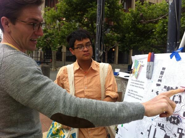 Todd, UCB planner, shows student Arty Zhang map of future protected Hearst bike lane. #bike2berk http://t.co/Jra7z0Ha9h