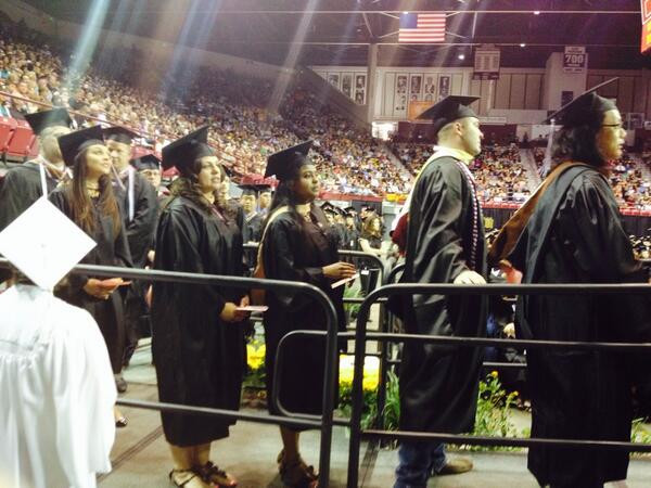 Masters students about to cross the stage. #nmsugrad http://t.co/E2mO3d5GWm